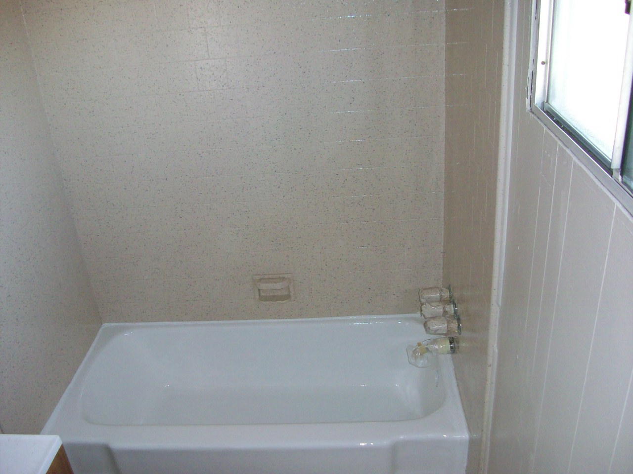 Porcelain tub & Tile walls (after. Tub done in high gloss white, walls in speckle finish 12-ACRT)